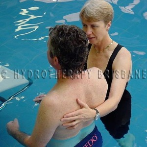 Image of physio treating patient with painful shoulder