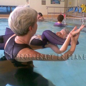 Image of physio treating patient in hydrotherapy pool using floats