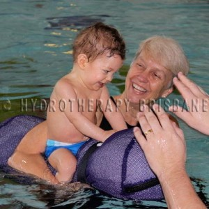 Image of child being treated in hydrotherapy pool